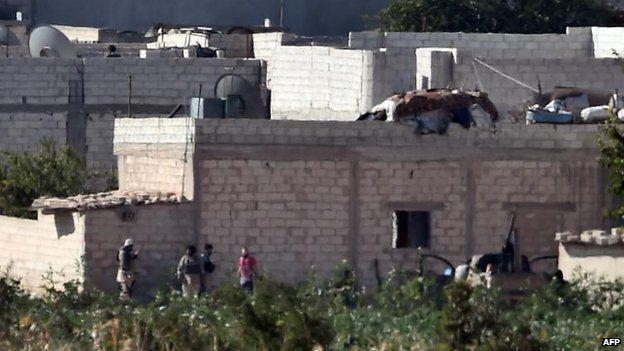Suspected IS militants in Kobane, 8 Oct