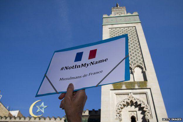 #notinmyname placard in France
