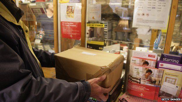 man posting parcel