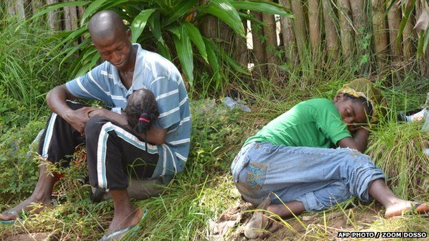A family sick from Ebola wait for treatment in Monrovia