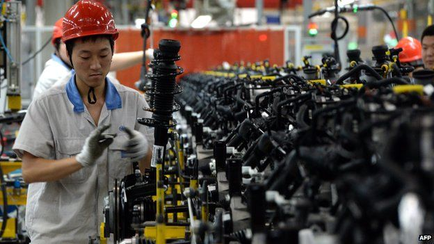 Chinese auto workers at the FAW-Volkswagen plant in Chengdu, China