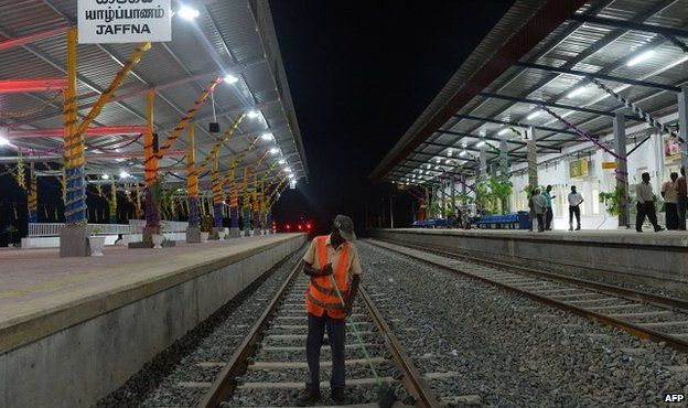 A Sri Lankan labourer cleans the tracks at the Jaffna railway station the capital of Sri Lankas northern province, 12 October 2014