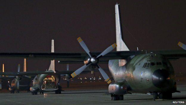 German Bundeswehr Transall C-160 plane carrying humanitarian aid stands on tarmac at Incirlik airbase near Adana, on 15 August 2014.