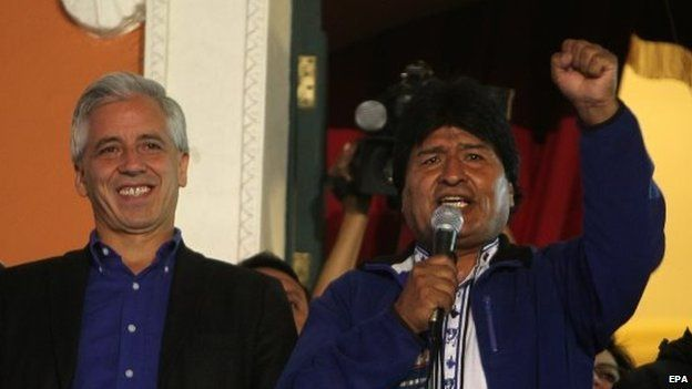 Bolivian president Evo Morales (right) and his vice-president Alvaro Garcia Linera (left) celebrate at the Government Palace in La Paz on 12 October 2014