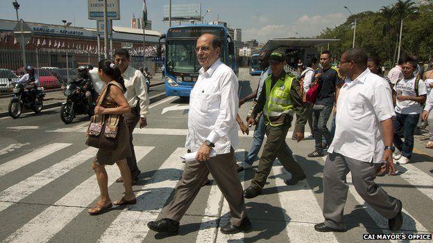 Cali mayor Dr Rodrigo Guerrero walks across a street in Cali