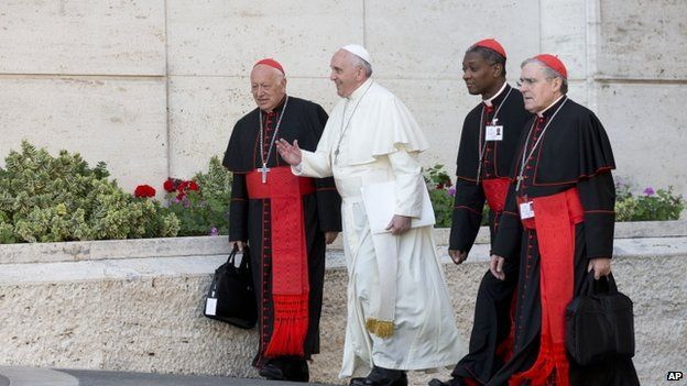 Pope Francis arrives with, from left, Chilean Cardinal Ricardo Ezzati Andrello, Haitian Cardinal Chibly Langlois, and Spanish Cardinal Lluis Martinez Sistach, 9 October