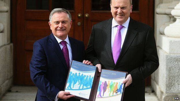 IMinister for Public Expenditure and Reform Brendan Howlin (left) and Minister for Finance Michael Noonan revealed a series of tax cuts and public spending announcements
