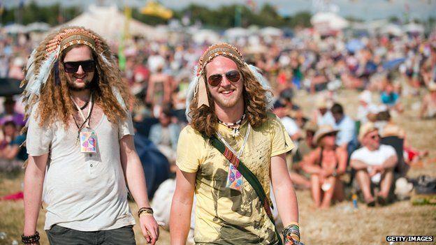Two festival goers wearing headdresses