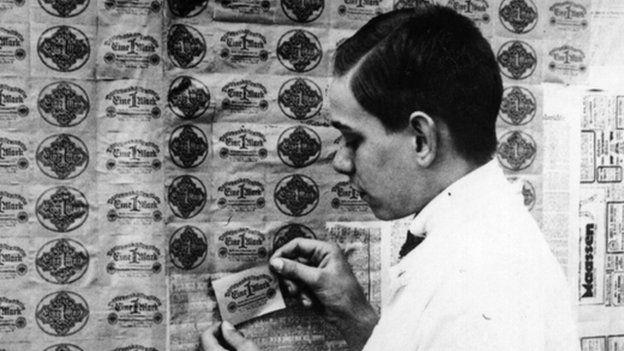 man using banknotes as wallpaper