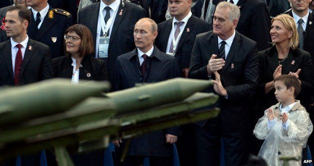 Russian President Vladimir Putin (centre) watches parade in Belgrade, 16 October