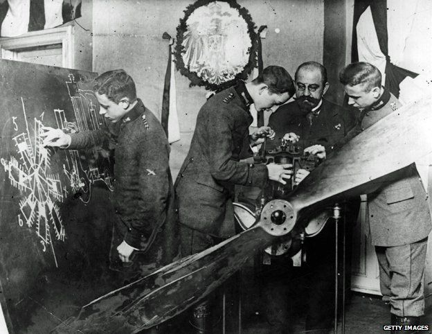 German pilots receive instruction on the mechanism of an aeroplane