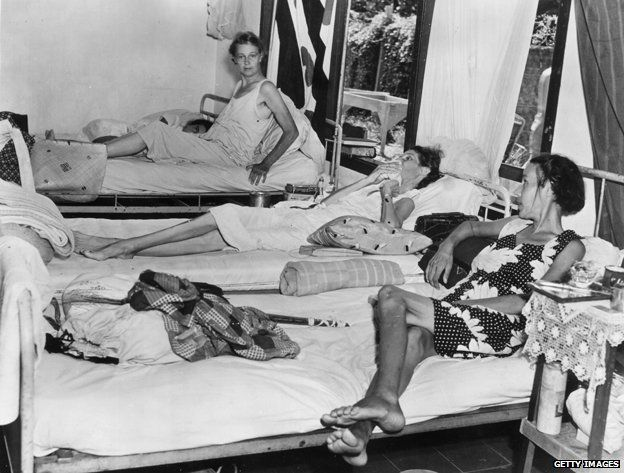 December 1945: Three female inmates in the hospital of the Tjideng internment camp on Java, Indonesia, suffering from dysentry and malnutrition.