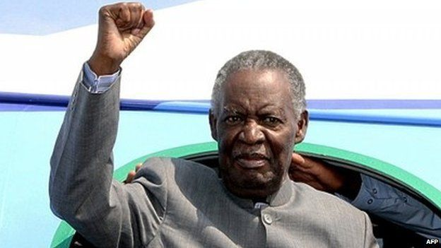 Zambian President Michael Sata gestures upon arrival at Solwezi airport before addressing supporters at an election campaign meeting on 10 September 2014