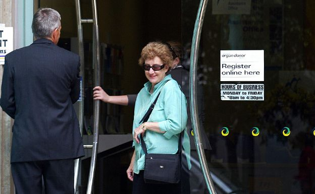Woman leaving a medicare building, Sydney, 2004