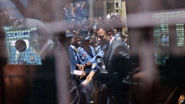 Oscar Pistorius leaves the Pretoria High Court, 21 Oct