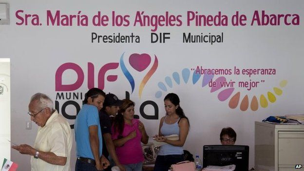 People work in the office of Maria de los Angeles Pineda Villa at the municipal headquarters in Iguala on 7 October, 2014.