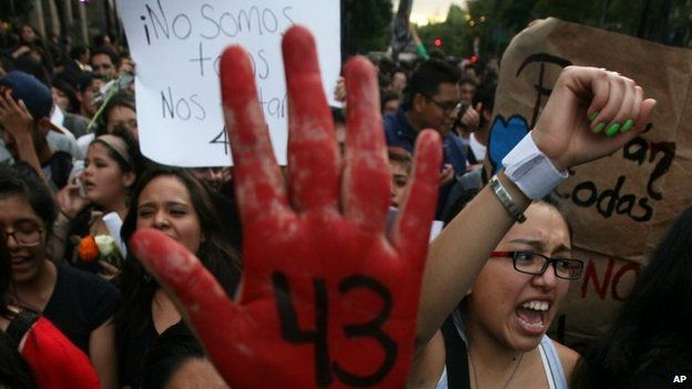 Demonstrators march in protest against the disappearance of 43 students from the Isidro Burgos rural teachers college in Mexico City on 22 October, 2014
