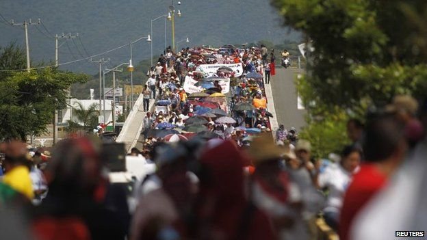 People participate in a demonstration to demand information on the 43 missing students in Iguala on 22 October, 2014.