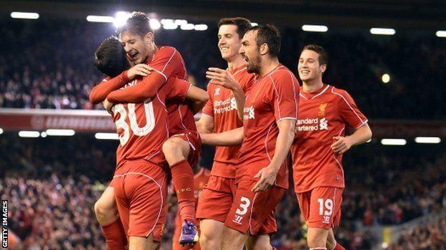 Suso celebrates with team-mates