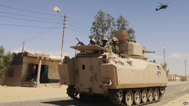 Egyptian Army troops backed by a helicopter gunship during a sweep through villages in Sheikh Zuweyid, northern Sinai, Egypt (November 2012)