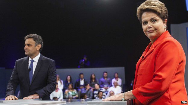 Brazilian presidential candidate and incumbent President Dilma Rousseff (R) and social democratic candidate Aecio Neves (L) attend a TV debate in Rio de Janeiro, Brazil, 24 October 2014