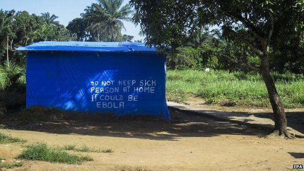 An Ebola information sign painted on a hut in Port Loko district one of the hardest hit areas due to the Ebola virus Sierra Leone 25 October 2014.