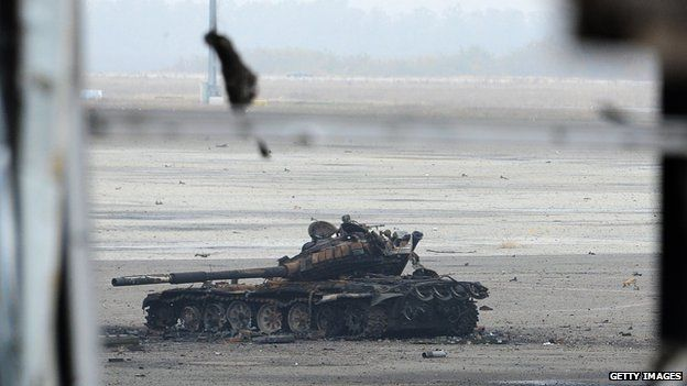 Knocked-out tanks litter the runway
