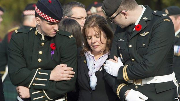 Kathy Cirillo is comforted by soldiers during the funeral procession for her son Cpl. Nathan Cirillo in Hamilton, Ontario, 28 October 2014