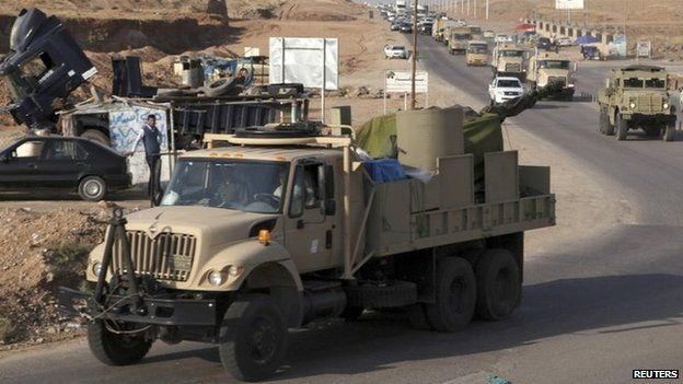 Convoy of Peshmerga fighters drive through Irbil, Iraq, en route to Turkey (28 October 2014)