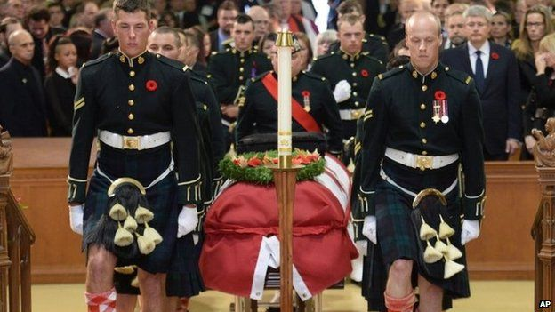 The casket of Cpl Nathan Cirillo is carried by pallbearers at his regimental funeral service in Hamilton, Ontario 28 October 2014
