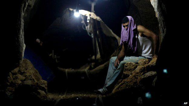A Palestinian worker rests inside a tunnel between Egypt and Gaza