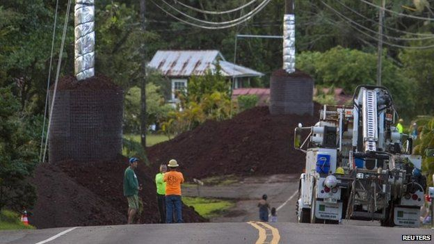 Construction crews prepare Pahoa Village Road as lava flow from Mt Kilauea approaches the village of Pahoa (28 October 2014)