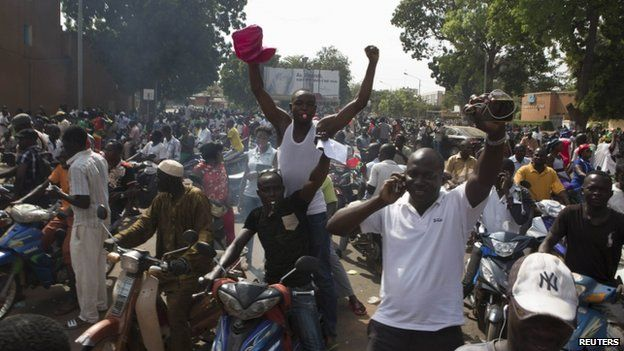 "People celebrate the departure of Burkina Faso""s President Blaise Compaore in Ouagadougou, capital of Burkina Faso"