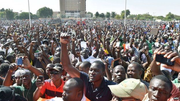Opposition supporters protest at the Place de la Nation in Burkina Faso's capital Ouagadougou, 2 November 2014