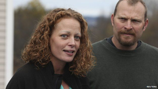 Nurse Kaci Hickox (L) joined by her boyfriend Ted Wilbur speak with the media outside of their home in Fort Kent, Maine October 31, 2014