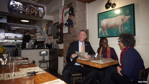 New York Mayor Bill de Blasio, his wife Chirlane McCray and New York Health commissioner Dr. Mary Travis Bassett (L-R) have lunch at The Meatball Shop in New York October 25, 2014