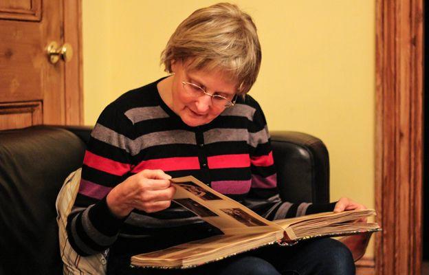 Daniela Walther looking through an old photo album, 2014