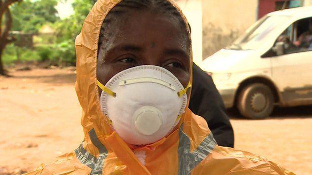 Mariatu Kagbo in a mask, Sierra Leone