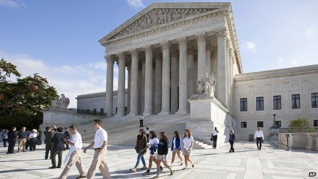 Visitors line up to enter the Supreme Court in Washington, Tuesday, Oct. 14, 2014,