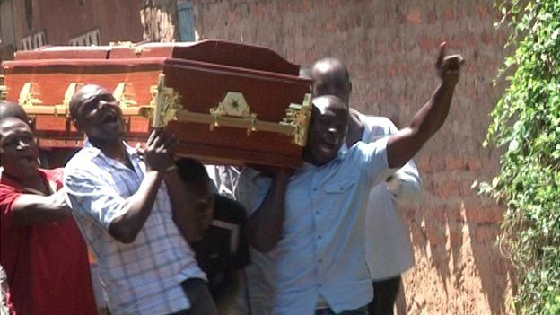 People carrying a coffin in Kisumu Kenya