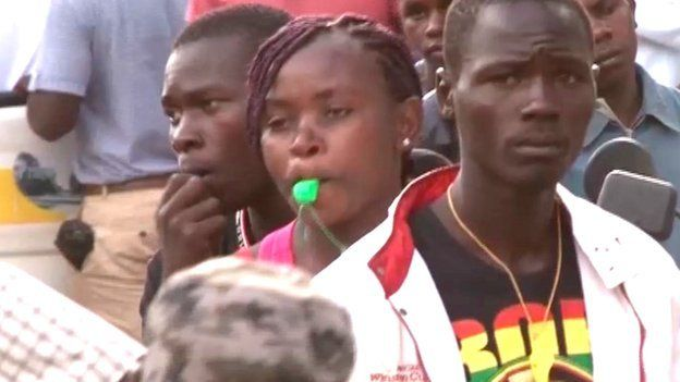 Professional mourners with whistles in Kisumu, Kenya