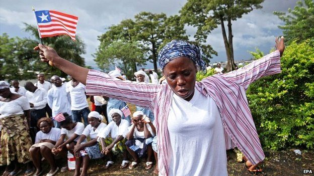 A Liberian woman prays for the end of Ebola in Monrovia, Liberia - 31 October 2014