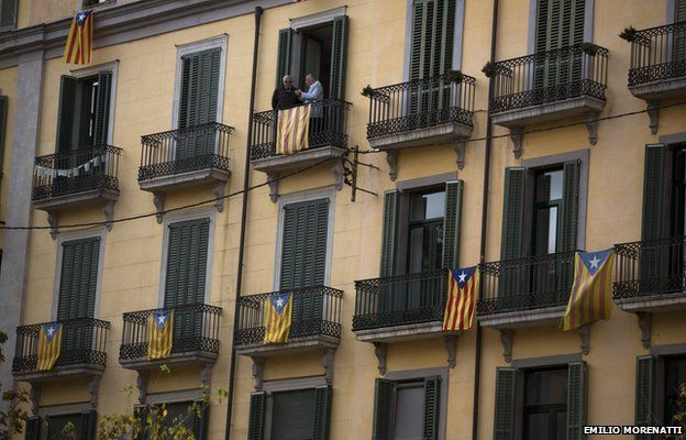 """Balconies are decorated with """"estelada"""" or pro independence flags ahead of voting on an informal poll, scheduled for next Sunday, in Girona, Spain, on Saturday Nov. 8, 2014"""