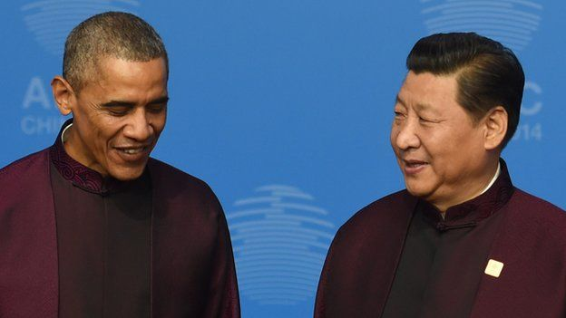 US President Barack Obama (L) stands with Chinese President Xi Jinping as they pose for a photo as he arrives for the Asia-Pacific Economic Cooperation