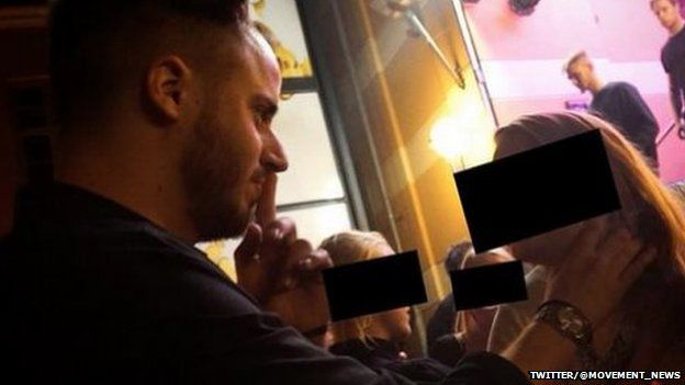 """Picture of Julien Blanc seemingly choking a girl in the street as part of his """"pick up"""" technique"""