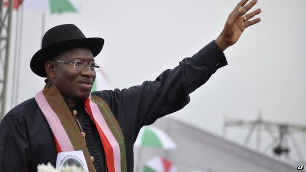 Nigeria President Goodluck Jonathan waves to his supporters from the podium after he declared his intention to run in elections next year in Abuja, Nigeria, 11 November 2014