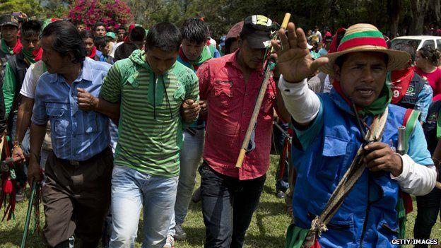 Members of the Nasa indigenous guard escort Farc rebels accused of murdering two Nasa leaders on 9 November, 2014, in Toribio