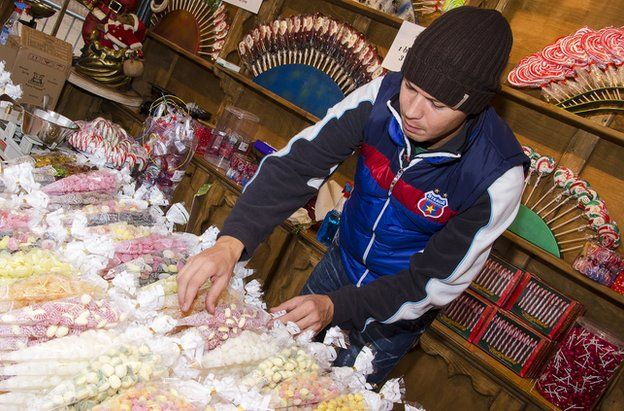 Cristian Lus arranging sweets