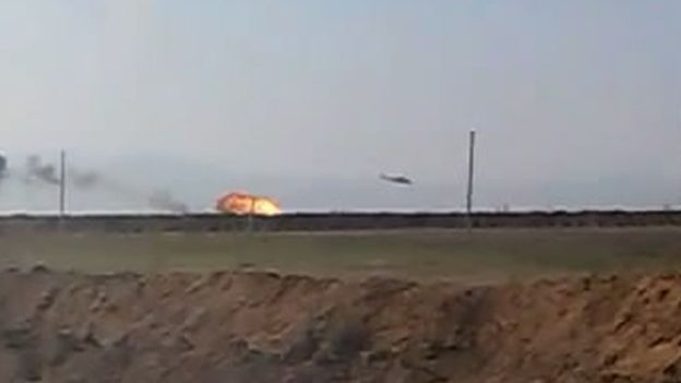 One of two Armenian helicopters in flames