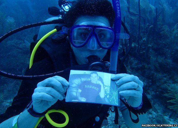 A diver with a photograph of CJ below the sea surface near the Dominican Republic